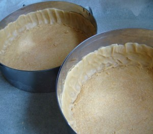The cake forms with the baked bottom in place and with remaining dough pressed along the sides.