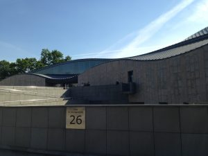 Entrance to Manggha Museum in Krakow, Poland on a sunny day with blue skies